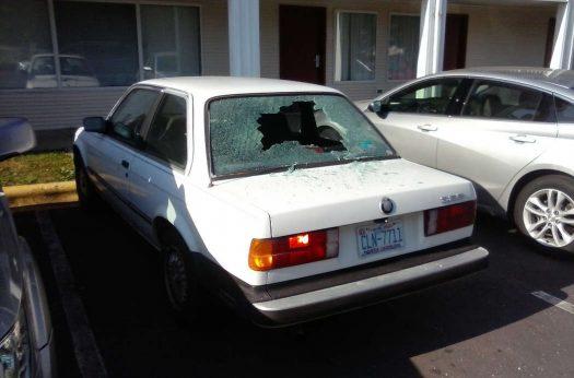 Vandalized auto Econo Lodge parking lot.
