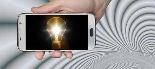 Mobile phone displaying image of a light bulb